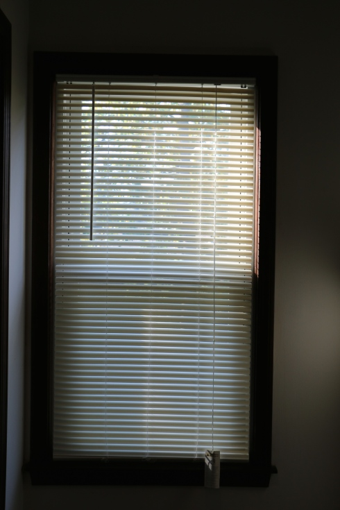 Blind wand is nearly in the center of the blinds and the window is smooched against the wall in the corner of the room....for no reason.